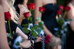 I like the idea of the bridesmaids carrying a single red rose, Cheaper than bouquets, super romantic, and reminiscent of Phantom of the Opera.