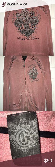 Crash & Burn Hoodie Size L (slightly oversized) crash n burn rust colored hoodie. Raw edge hem with filigree zipper pull. Back has black design with rhinestones. Buckle Tops Sweatshirts & Hoodies