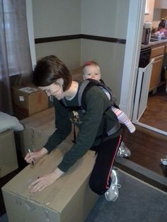 Moving with Baby #babywearing #Ergobaby