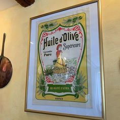 Framed French dish towel in the kitchen at Oustau Le Bijou