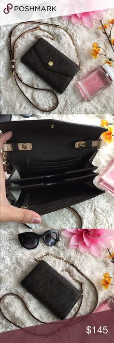 """🌸OFFERS?🌸Michael Kors All Leather Wallet/Crosbdy 🌷Authentic🌷Excellent shape. Minimal sign of use. All parts intact amd functional. Fetaures removable/adjustable strap, snap button to close, 3 main compartment, 3 card slot, zipper pocket, outside slip pocket, gold hardware and leather and chain adjustable strap. Very functional piece! Use as a crossbody or wallet alone. Fits up to iphone 6 📱 Don't be shy to make an offer💕 Dimensions: 6.5""""x4"""" ✨Feel free to bundle with other bag✨…"""