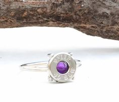 Would like it with a diamond or maybe my birthstone. Bullet Casing Ring  Amethyst  Recycled Shell by LamplighterJewelry, $85.00