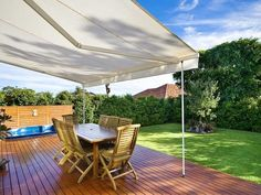 Indoor-outdoor outdoor living design with deck & shade sail using grass - Outdoor Living Photo 454626