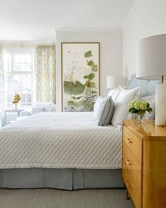 blue and white bedroom design by blue print interiors | large scale art by arienne lepretre | white coverlet with blue bedskirt | sycamore side table from blue print | blueprintstore.com