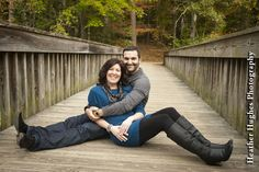 Fall engagement portrait on a bridge by Heather Hughes Photography.