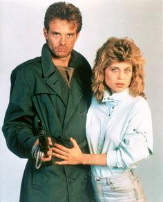 Michael Biehn as Kyle Reese and Linda Hamilton as Sarah Connor in THE TERMINATOR (1984).