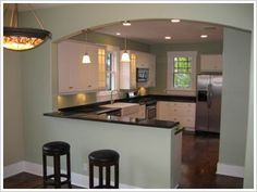 Bungalow floor plan.  Open wall between kitchen and dining.