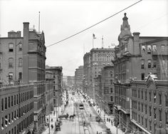 "Detroit circa 1906. ""Griswold Street."" My favorite detail here: The American Still Alarm auto at lower right."