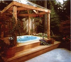 Hot Tub Ideas Backyard wooden hot tub that connects two lawn levels and looks like it is built in Hot Tub Even In The Rain