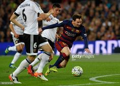 Barcelona's Argentinian forward Lionel Messi vies with Valencia's Argentinian midfielder Enzo Perez during the Spanish league football match FC...