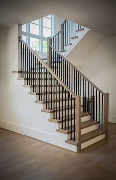 Modern Stair Railing Design A modern railing can increase the visual appeal of your stairs and potentially the value of your home. Learn about our modern railing design process. Black Stair Railing, Interior Stair Railing, Wrought Iron Stair Railing, Black Stairs, Stair Railing Design, Metal Stairs, Staircase Railings, Staircase Ideas, Modern Railings For Stairs
