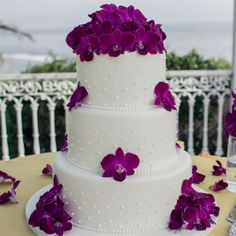 Purple Orchid and Swiss Dot Cake // Steph Grant Photography // Rossmoor Pastries - Wedding Cake Studio // http://www.theknot.com/weddings/album/a-romantic-outdoor-wedding-in-laguna-beach-ca-139871