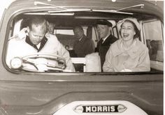 Philip and the Queen. Looks like he's driving, and he may be lost. She's laughing. Typical marriage!!