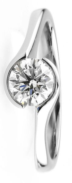 The 'Zoe' diamond engagement ring embraces a round brilliant cut diamond held gracefully within a substantial and luxurious band crafted in your choice of Platinum or 18ct Gold. Now available in Fairtrade Gold.