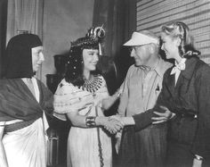 """Cecil B. Demille introducing Grace Kelly to Ann Baxter on the set of """"The Ten Commandments"""" ."""