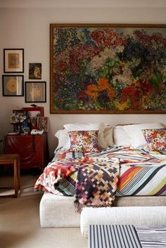 I love the vintage feel of this room and that huge picture above the bed. Plus the colors are amazing.