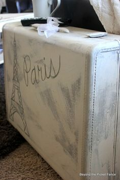 Paris Suitcase Side Table-Repurposed Vintage Suitcase http://bec4-beyondthepicketfence.blogspot.com/2014/02/paris-suitcase-side-table.html