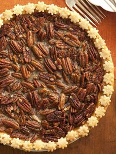 Your sweet tooth won't know what hit it when you bite into this Brown Sugar Pecan Pie. With maple syrup, brown sugar and a hint of bourbon, you won't be able to stop after just one piece. Decorate the crust with a cookie cutter flower border to give it an extra pretty touch. Click through for this and more easy pie recipes.