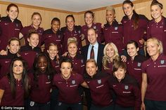 Passion: William, seen last week with the England lionesses, is passionate about football