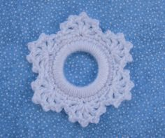 "Lacy Snowflake is made by crocheting around a 2"" plastic ring. It is the first in my ""Ringing In Christmas"" ornament series. I will be releasing one pattern each week on my blog."