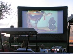 Golf cart drive in movie complete with cartoons.