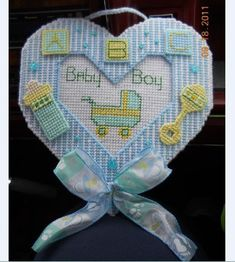 Items similar to Baby, girl or boy, gift Wreath, wall hanging, plastic canvas (made upon Order) on Etsy Plastic Canvas Ornaments, Plastic Canvas Christmas, Plastic Canvas Crafts, Crafts To Make And Sell, New Crafts, Baby Crafts, Plastic Canvas Stitches, Plastic Canvas Patterns, Baby Patterns