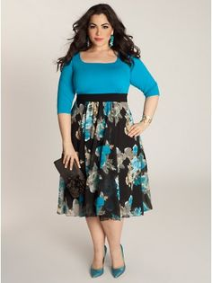 The Ivy dress features a painterly floral print that will enliven a tired wardrobe. The bright blue top—broken up by solid black waistband—will flatter your figure. Keep the dress the star by accessorizing with modest jewelry and neutral or black pumps.