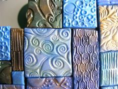 Look what amazing things can be done with air dry clay!  From Sid and his blogspot:  Harpies Crafty Corner.  He rolled out the clay by hand, added texture and mica powder, cut the pieces and assembled them around a mirror.