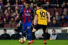 The FC Barcelona player Neymar da Silva from Brasil against The Malaga CF player Juampi from Spain during the La Liga match between FC Barcelona vs...