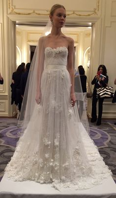 Image from http://www.brides.com/blogs/aisle-say/marchesa-spring-2016-wedding-dresses-bridal-runway-show-romantic-gown.jpg.