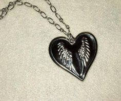 Hey, I found this really awesome Etsy listing at https://www.etsy.com/listing/67807022/my-dark-valentine-black-heart-with-wings