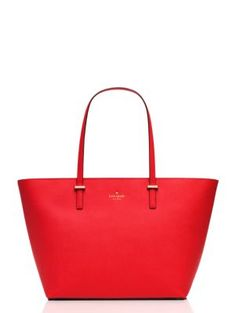 this bold, roomy tote captures is a quintessential carryall that's sure to bring a powerful pop of color to any look.