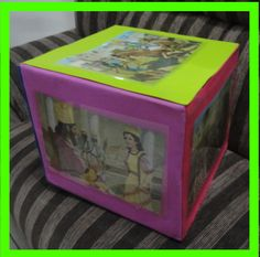 Este recurso foi confeccionado pela coordenadora Téssia.  Ela utilizou: -1 caixa de papelão; -cola de silicone - eva em cores variadas -6 tr...