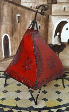 Swiriya Henna Lamp Red - $29.99  The henna lamps are handmade from goat skin stretched over a firm iron frame, tattooed with henna paste by using Moroccan art designs.