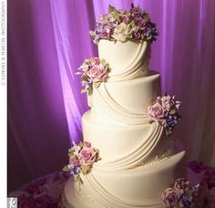beautifully draped lavender accented wedding cake