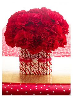 DIY Candy Cane Vase - Spruce up an old vase this Christmas by either tying or hot gluing candy canes around the surface. Festive and elegant!