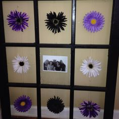 Get an old window pane and paint it whatever color you desire add the flowers and picture in the middle!