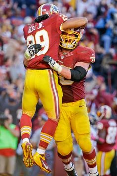 Washington Redskins running back Roy Helu is picked up guard Kory Lichtensteiger, right, after scoring the game winning touchdown. The Redskins defeated the Bears 45-41. (Alex Brandon/AP)