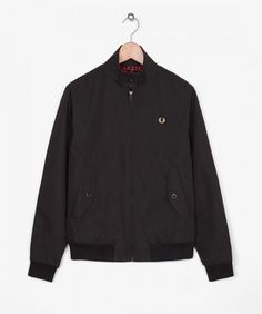 Based on a British subculture classic, the made in England Harrington is crafted in a lightly coated polyester/cotton blend fabric complete with a cotton Stewart tartan lining. Construction details include a 'batwing' yoke, 2 front flap pockets and a zipp