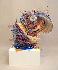 Woven sculpture by Nathalie Miebach based on daily temp readings compared to historical trends