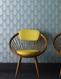 blue patterned wall with yellow chair= #POP