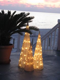 Xmas Decor - tomato cages covered with gauze and filled with lights Burlap Christmas Tree, Beach Christmas, Coastal Christmas, Outdoor Christmas Decorations, Holiday Tree, Retro Christmas, Beautiful Christmas, Holiday Decor, Tropical Christmas