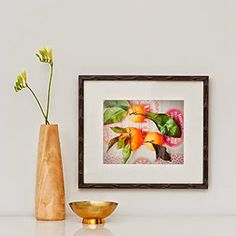@lupen's bright oranges look so fine in our black bamboo Bali frame!