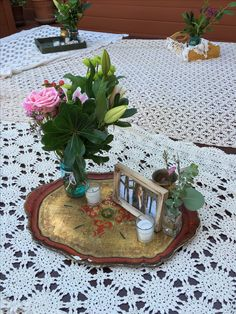 Sweet crochet and vintage Italian wood trays and florals.