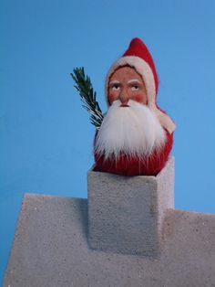 Detail of a 10,3 inch Paper mache snow house *German Santa* candy container by Paul Turner studio