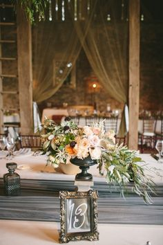 Nature-inspired barn wedding #centerpieces | Photography: http://laurenfairphotography.com | Design: www.oleanderbotanicals.com