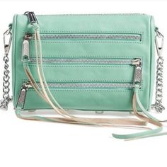 Rebecca Minkoff 5 Zip Crossbody Authentic Rebecca Minkoff! New amazing condition, great price! Very trendy style in stores now! Mint green genuine soft leather!  I'll only consider offers made with the offer button.💰 No trades or low ball offers.🚫 My items are already extremely discounted and sell very fast. So, if you see something you like... make an offer! 😊❤️  Thanks for looking around my closet! I am always adding new items! 💖🎀👗👛👠💄  BUNDLE & SAVE 10%!  Top 10% rated seller…