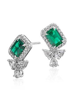 Exquisite elegance, these gemstone and diamond earrings showcase vibrant emeralds framed by sparkling diamonds set in 18k white gold.