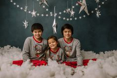 holiday mini session photo shoot christmas pajamas bed siblings silver hanging stars blue backdrop puffy cotton clouds reindeer Holiday Mini Session, Mini Sessions, Cotton Clouds, Hanging Stars, Bucks County, Christmas Pajamas, Boudoir Photographer, Siblings, Reindeer