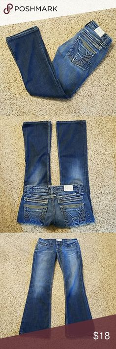 Taverniti So Jeans, Sacha, distressed, decorated Sacha cut, low to mid-rise with flared legs. Heavy weight jeans with a lot of detailed stitching. Factory fading, whiskering and distressing. Size 28. Waist approximately 15.5 inches across flat with stretch. Front rise approximately 7 inches. Inseam approximately 31 inches. Jeans have been shortened and there is wear on right back hem, see pic 7 and 8. Price adjusted. 99% cotton, 1% Lycra. Except for hems in very good pre-loved condition, no…